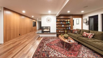 Wood panelling behind shelving and along main hallway warm white walls throughout.