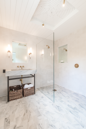 Master bathroom with quartzite floor and basin, Heath wall tiles, and sunken mirrors