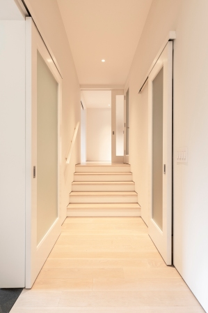 Wide-plank white oak flooring and baseboard free construction
